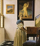 Johannes Vermeer Lady Standing at a Virginal 1670