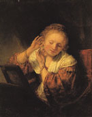 A Young Woman Trying on Earrings 1657 - Rembrandt Van Rijn